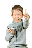 Laughing boy holding a thermometer and shows thumb isolated on w Royalty Free Stock Photo