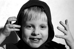 Laughing boy in the hood Stock Images
