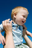 Laughing boy in mothers arms Royalty Free Stock Photography