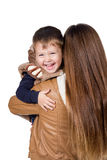 Laughing boy in mum on arms Stock Photos