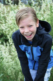 Laughing boy. Outside in the garden Stock Photo