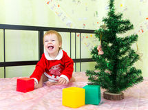 Laughing boy playing with bricks Royalty Free Stock Photography