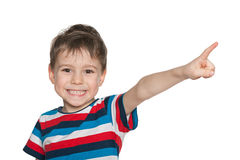Laughing boy points aside Royalty Free Stock Photo
