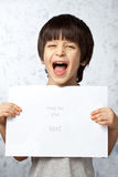 Laughing boy with a poster in hands Stock Photos
