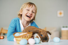 Laughing boy with rabbit Royalty Free Stock Images