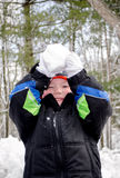 Laughing boy ready to throw a big snow ball stock photos