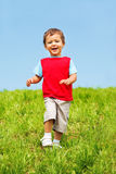 Laughing boy running Royalty Free Stock Photo