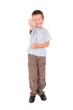 Laughing boy shows fig Stock Photo