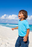 Laughing boy standing on the sandy beach Royalty Free Stock Photography