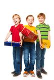 Laughing boys with presents Stock Photo