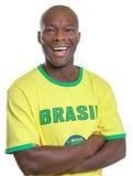 Laughing brazilian football fan Stock Photos
