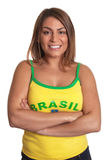 Laughing brazilian girl with crossed arms Stock Photo