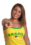 Laughing brazilian girl pointing at camera Stock Images