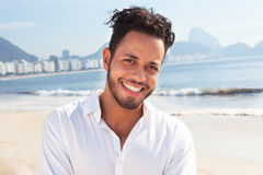 Laughing brazilian man at Copacabana beach Stock Photos