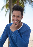 Laughing brazilian man with palms in the background Stock Image