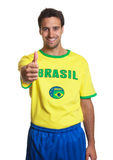Laughing brazilian soccer fan showing thumb up Royalty Free Stock Image
