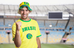Laughing brazilian soccer fan at stadium Royalty Free Stock Photography