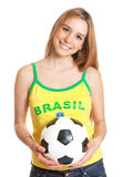 Laughing brazilian sports fan with ball Stock Photography