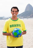 Laughing brazilian sports fan with ball at Rio de Janeiro Stock Photography