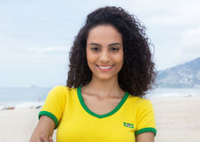 Laughing brazilian sports fan with curly hair at Copacabana beach Royalty Free Stock Photo