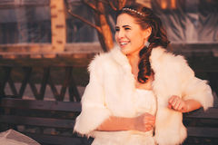Laughing bride on bench Royalty Free Stock Photos