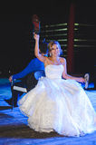 Laughing Bride with Shoe. Laughing bride holding up groom`s shoe Royalty Free Stock Images