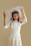 Laughing bride with veil Stock Images