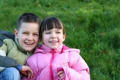 Laughing Brother And Sister In The Meadow Royalty Free Stock Photos