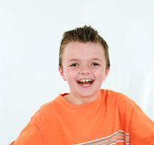 Laughing brunette boy Royalty Free Stock Images