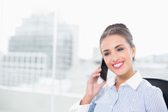Laughing brunette businesswoman phoning with smartphone Stock Images