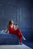 Laughing brunette with a glass of red wine Stock Photo