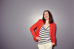 Laughing brunette in red coat Stock Photos