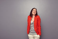 Laughing brunette standing Royalty Free Stock Photography
