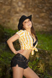 Laughing brunette woman with cowboy hat Stock Images