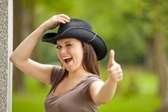 Laughing brunette woman with cowboy hat Stock Photography