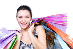 Laughing brunette woman with purchase Royalty Free Stock Image