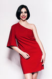 Laughing brunette woman in red dress Royalty Free Stock Images