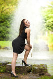 Laughing brunette woman standing at pond Royalty Free Stock Images