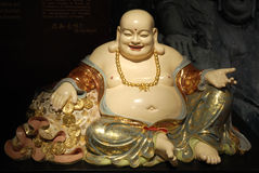 The Laughing Buddha. Sometimes known as Budai or Angida.  He is characterised by his large belly, bald head and wide smile Stock Photos