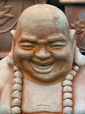Laughing Buddha. A laughing Buddha statue in terracotta Stock Photo