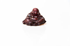 Laughing Buddha. Brown laughing Buddha with peaceful mind stock image