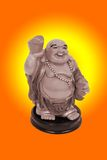 Laughing Buddha carrying gold ingot Royalty Free Stock Photography