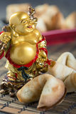 Laughing Buddha and the Chinese cookies. Stock Photography