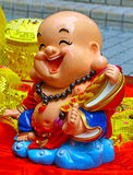 Laughing buddha. Cute statue of traditional chinese feng shui laughing buddha displayed in a garden during chinese new year Royalty Free Stock Image