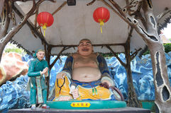 The Laughing Buddha statue at Haw Par Villa in Singapore. stock image