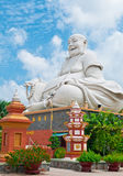 Laughing Buddha of Vinh Trang Pagoda, Vietnam. An enormous laughing buddha statue at Vinh Trang Pagoda, Vietnam Royalty Free Stock Photo