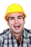 Laughing builder Stock Photo