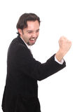 Laughing business man with hand clenched to fist Stock Photos