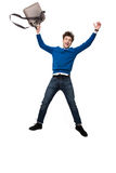 Laughing business man jumping with bag Royalty Free Stock Image