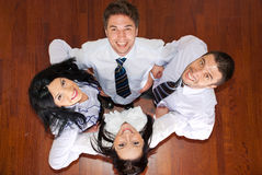 Laughing business people in a huddle Stock Photography